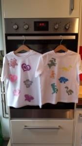2 finished t-shirts hanging up to dry!